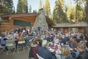 Group gathering on the deck at the Wedding and Event Center at The Redwoods In Yosemite